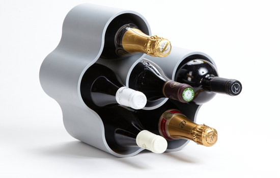 the provenance ecofriendly six bottle wine rack is a simple minimal and curvaceous six bottle wine rack made from a single extruded section of recycled